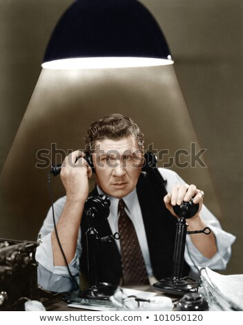 Businessman juggling two telephones Stock photo © photography33