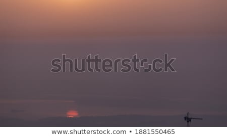 sun reflection over city rooftops Stock photo © sirylok