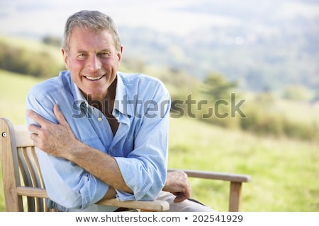 Senior man relaxing in the sunshine Stock photo © photography33