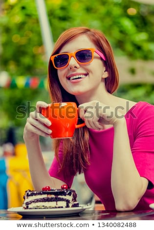 Style redhead girl sitting on the bench in the cafe Stock photo © Massonforstock