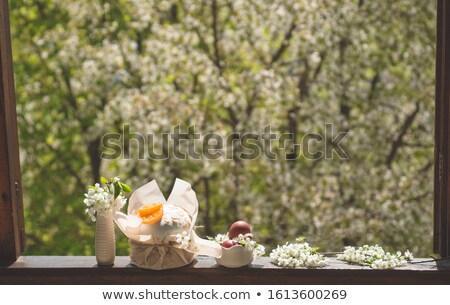 Húsvéti tojások ablak színes tojások tollak üveg tojások Stock fotó © silent47