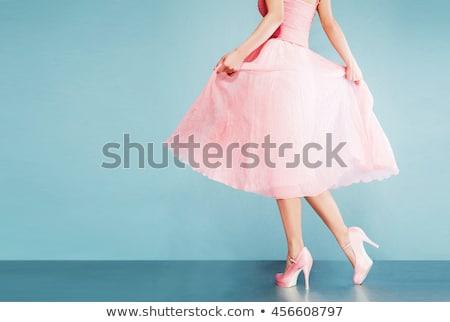 Retro lány rózsaszín ruha áll egy Stock fotó © maros_b