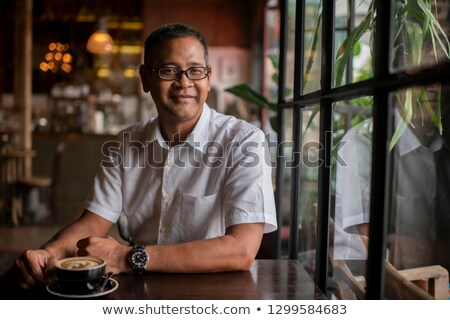 man closeup portrait at cafe drinking coffee stock photo © maridav