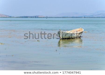 öreg evezős csónak színes tengerpart víz kék Stock fotó © cla78