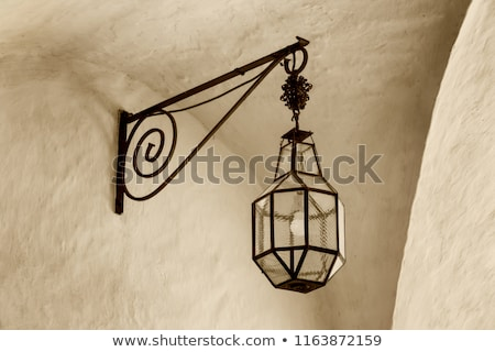 Old wrought iron lamp on a building exterior Stock photo © juniart