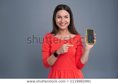 Portrait of a businesswoman holding a red 'Love' text Stock photo © bmonteny