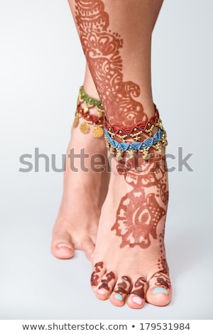 Legs decorated with indian mehandi painted henna close up Stock photo © master1305
