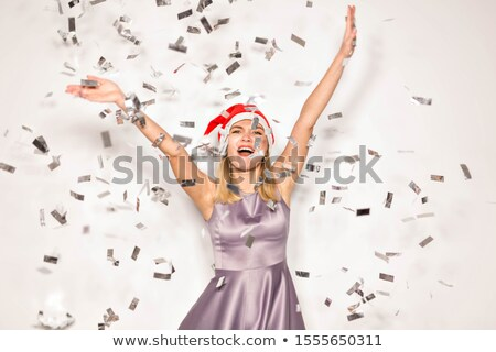 Young woman in Santa Claus clothes over Christmas background Stock photo © ankarb