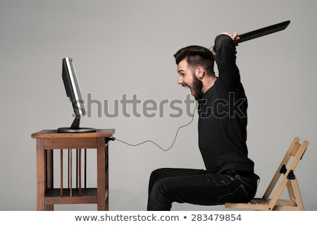 Сток-фото: Young Angry Man Destroys A Computer
