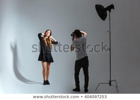 Beautiful female model posing in a photographic studio Stock photo © lightpoet