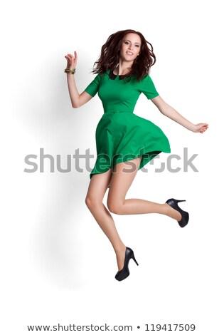 Jonge vrouw groene jurk geïsoleerd witte gelukkig Stockfoto © Elnur