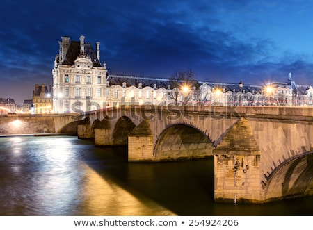 Louvre múzeum éjszaka egy legnagyobb világ Stock fotó © artjazz