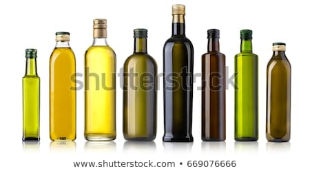 Olive oil three glass bottles isolated Stock photo © marimorena