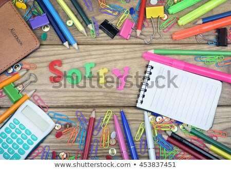 sorry word and office tools on wooden table stock photo © fuzzbones0