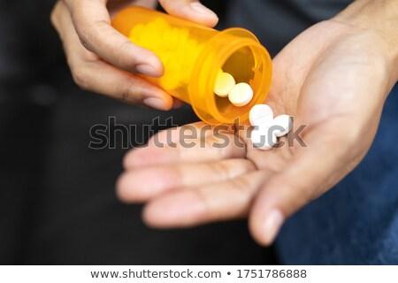 médico · pílulas · mão · médico · hospital - foto stock © oleksandro