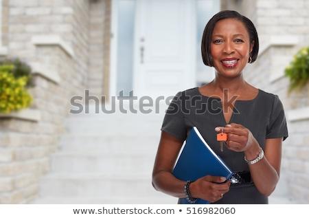 Agente immobiliare donna chiave sorridere afro americano Foto d'archivio © Kurhan