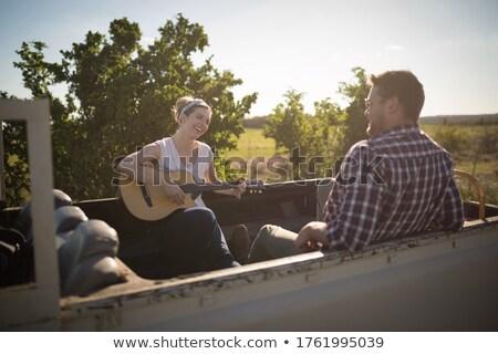 nő · játszik · gitár · hipszter · énekel · zene - stock fotó © wavebreak_media