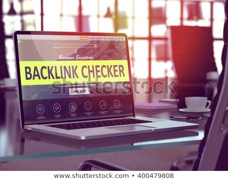 Backlink Checker - on Laptop Screen. Closeup. 3D. Stock photo © tashatuvango