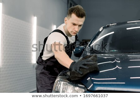 Hand Wearing Blue Glove Polishing Car Hood With Cloth Stock photo © AndreyPopov