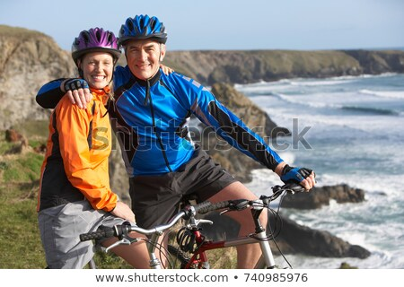 Middle aged couple riding bicycles Stock photo © IS2