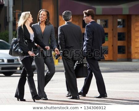 Two business women walking on sidewalk Stock photo © IS2