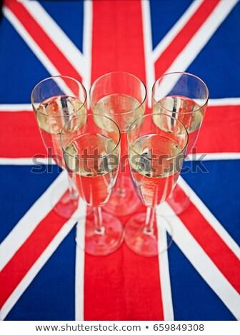 Gözlük şampanya İngiliz bayrağı bayrak başarı kimse Stok fotoğraf © IS2