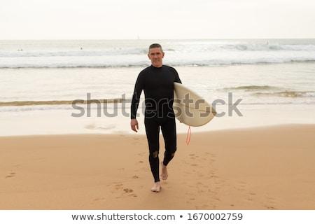 Adam yürüyüş sörf serin çit Avrupa Stok fotoğraf © IS2