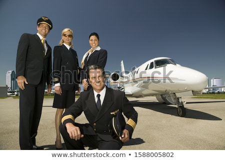 Flight attendant next to private jet. Stock photo © IS2