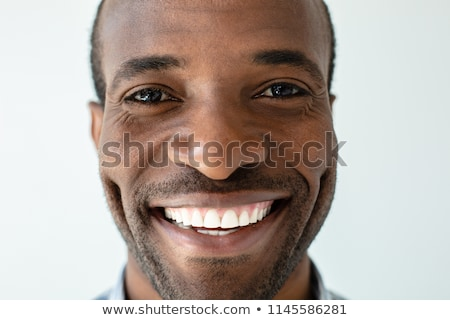 Close up portrait of a handsome young businessman Stock photo © deandrobot
