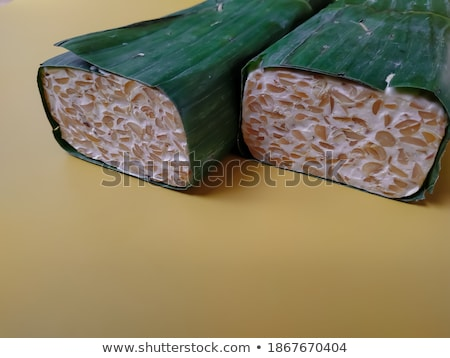 tempeh wrapped in leaf, top view. Stock photo © szefei