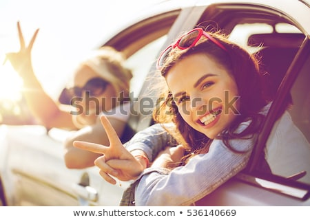 happy teenage girls or women in car at seaside Stock photo © dolgachov