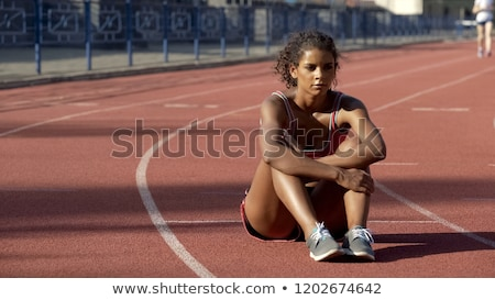 Frustrated and tired sporty woman sitting outdoor Stock photo © boggy