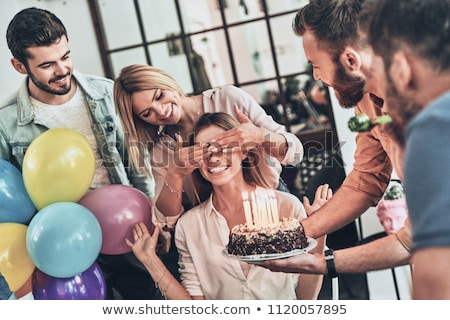 man with cake and friends at birthday party Stock photo © dolgachov