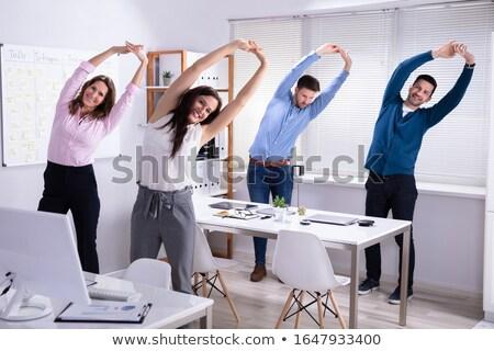 осуществлять за столе счастливым Сток-фото © AndreyPopov