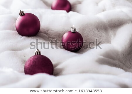 Purple Christmas baubles on white fluffy fur backdrop, luxury wi Stock photo © Anneleven
