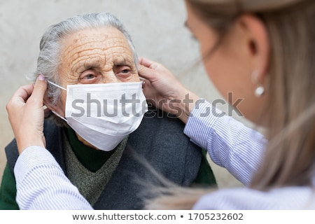 Oude patiënt thuiszorg ondersteuning dienst glimlach Stockfoto © AndreyPopov