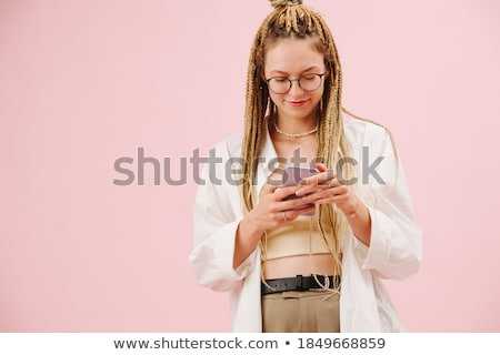 Portrait of a beautiful young girl with colored yarn in her mout Stock photo © HASLOO