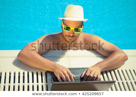 человека используя ноутбук край воды телефон природы Сток-фото © photography33