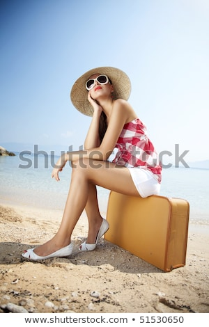 woman with suitcase on the beach Stock photo © dotshock