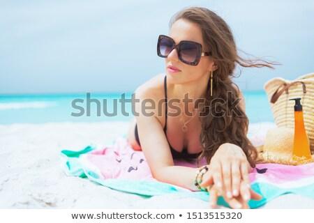 привлекательный брюнетка пляжное полотенце тело лет Сток-фото © photography33
