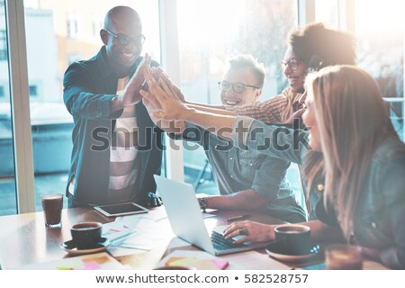 Business partners giving each other a high-five Stock photo © photography33