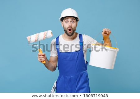 Decorator holding tin of blue paint Stock photo © photography33
