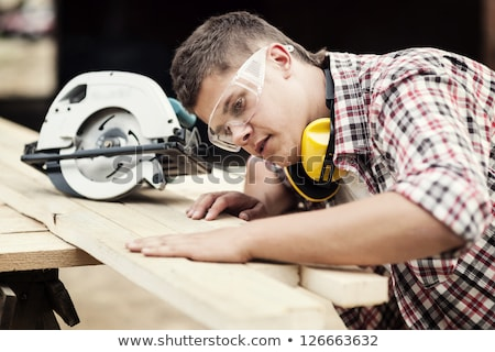 young man with an electric saw stock photo © photography33