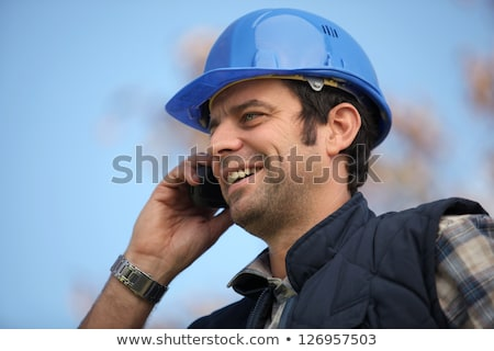 Foreman talking to colleagues via radio Stock photo © photography33
