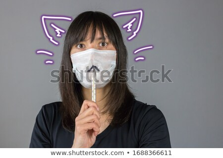 Young woman holding a picture of a mouth to her ear Stock photo © photography33