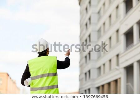 Ingénieur réfléchissant gilet plans bâtiment été Photo stock © photography33