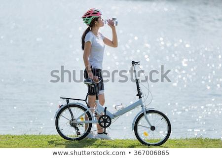 biker with bottle of water in vineyard stock photo © phbcz