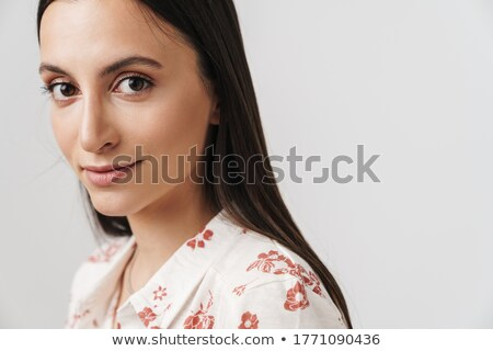 brunette woman with jewellery looking at camera Stock photo © chesterf
