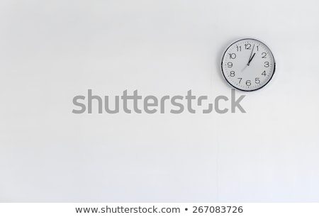 Grey and white wall clock Stock photo © Anettphoto