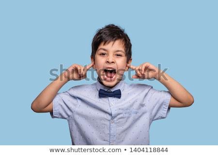 boy closing his shirt Stock photo © meinzahn